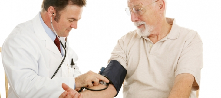 Doctor examining elderly male patient