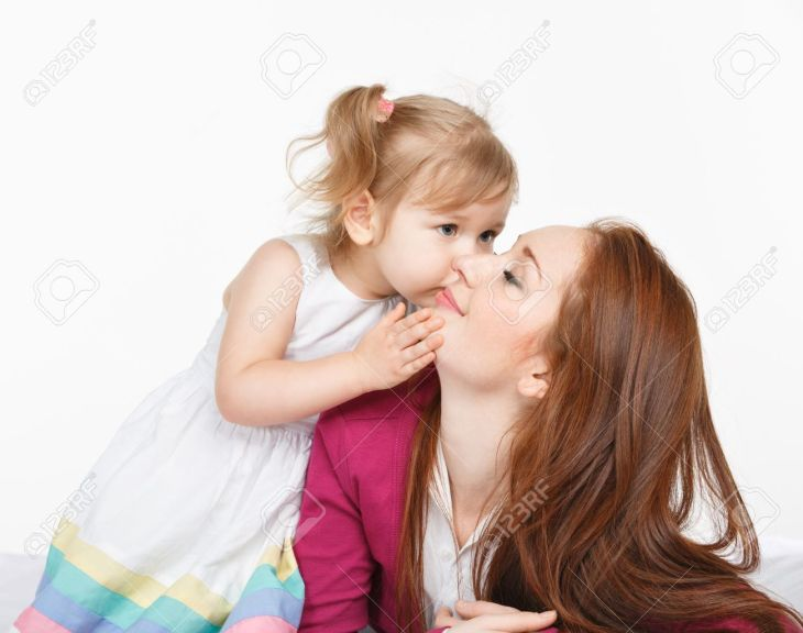 19430973-Happy-woman-and-young-girl-child-smiling-in-bed-Mother-day-concept-Stock-Photo